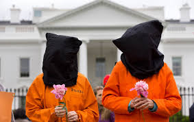 how should american war crimes be punished the nation two protesters demonstrate for the closure of the united states guantanamo bay detention camp in front of the white house washington dc 24 2013