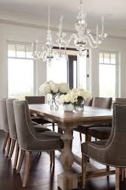 hardware dining table exclusive: restoration hardware c monastery table and martine upholstered armchairs chandeliers