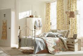 shabby chic bedroom decorating ideas with iron bed frame complete with awesome nightstand and lamp also with white wardrobe awesome shabby chic bedroom
