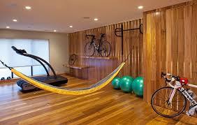 california contemporary mid sized trendy multiuse home gym photo in san francisco with medium tone hardwood bespoke wall storage