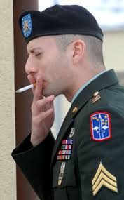 Sgt. Michael Leahy Jr. smokes a cigarette during a recess in his court-martial Thursday at Vilseck, Germany. Seth Robson / ©Stars and Stripes - 1630633556