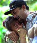 Gilda Funes and her husband Jose Cruz embrace as six of their immediate family members, three from her side and three from his, are lowered into a common ... - salvador300-toe