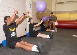 occupational physical assessment test tradoc a group of female recruits perform the seated power throw one of the