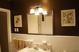 bathroom interior with brown wall paint colors and lighting fixtures over mirror above mirror lighting bathrooms