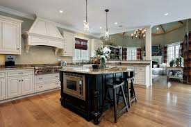 countertops dark wood kitchen islands table: within this sprawling open plan kitchen the island stands in sharp contrast