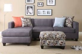 dark grey apartment sized sectional idea with multi color accent pillows and floral patterned ottoman table apt furniture small space living