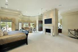 big master bedrooms couch bedroom fireplace: a winding staircase leads up to this top floor master bedroom with a center fireplace