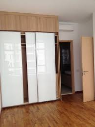 glorious white glozzy sliding doors built in wardrobe on fake wooden floors in contemporary master bedroom bedroom closet furniture