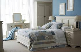 give star for shabby chic bedroom decorating ideas with iron bed frame complete with awesome nightstand and lamp also with white wardrobe photos above awesome shabby chic bedroom