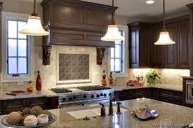 dark wood walnut kitchen classic wood hood with tumbled travertine and contrasting metal tile b