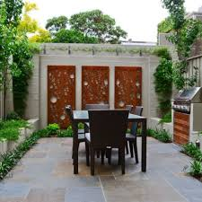 designs outdoor wall art: outdoor patio among dining also kitchen completed with artistic perforated wooden panels for wall art decor