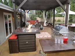patio outdoor stone kitchen bar:  hrmc outdoor kitchen with tabletop fire pit sxjpgrendhgtvcom