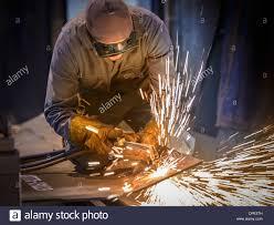 welder using oxyacetylene torch in factory stock photo royalty stock photo welder using oxyacetylene torch in factory