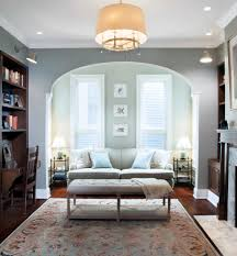 living room with bed: marble table lamps living room traditional with arched wall opening area