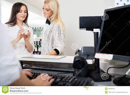 s clerk assisting w in pharmacy stock photo image  s clerk assisting w in pharmacy