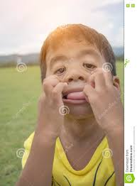 child boy five years old act like a ghost trying to scare mommy child boy five years old act like a ghost trying to scare mommy put on