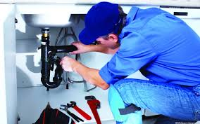 This Anniston plumber can service all your plumbing needs. He can play you a song too.