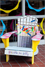 brightly painted adirondack chairs scattered around needham are part of a chair to remember bright painted furniture