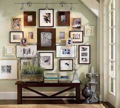 picture frame wall decorating idea for living room with unique tight collage replacement and using cone charm impression living room lighting ideas