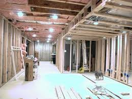 here is a shot looking the other way towards the theater hallway left and bar center basement lighting options