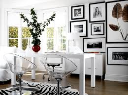 modern white office design with white parson desk black white zebra cowhide rug white tapered lamp lucite chairs and black white photo gallery black and white office