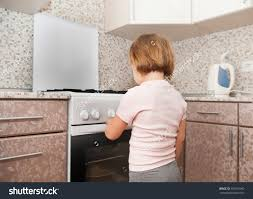 child out supervision of parents playing stove stock save to a lightbox