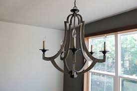amazing how to mix and match lighting for a designer look katie jane and metal chandelier amazing wooden chandelier