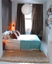 mesmerizing small bedroom interior design ideas with white lantern also double sized bed and blue blanket bed design design ideas small room bedroom