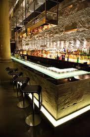 mint leaf lounge london lighting into lighting design julian taylor associates the sleek modern stools paired with the natural stone of the bar bar lighting design