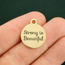 Positivity Gold Stainless Steel <b>Charm</b> - <b>Strong is beautiful</b> - Exclusive ...
