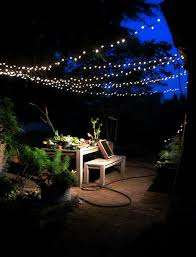lighting a backyard with lights for party backyard party lighting