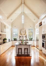 lighting for high ceilings kitchen transitional with black countertop counter stools ceiling dining room lights photo 2
