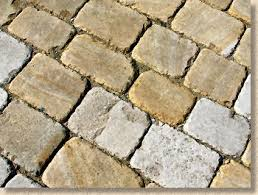 patio slab sets: for sawn setts a kiln dried jointing sand as sold for jointing block paving is normally used but for sett pavements using fair picked or other