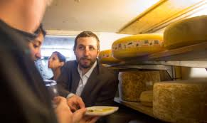 cheese lovers come us as we descend into a cambridge shop s christopher vamos cheese cave manager at formaggio kitchen offers samples during a subterranean tour