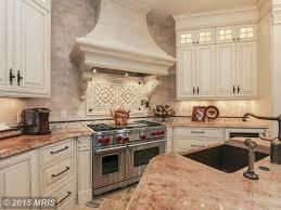 limestone tiles kitchen: traditional kitchen with raja pink granite countertop toulouse scrolls toulouse medallions backsplash limestone