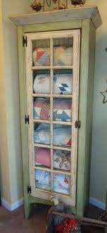 set cabinet full mini summer: or just for my stash of blankets sheets towels etc could even wrap boxes bins in mini printed quilt patterns to create the effect of a quilt