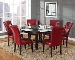 person dining room table foter: if you like giving parties and inviting family for delicious dinners opt for a dining room table with a lazy susan the turnable tray makes the serving