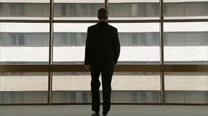 Image result for photo of man in suit walking
