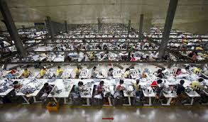 how to improve working conditions in the developing world labourers work at a large garment factory