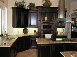 painted kitchen cabinets vintage cream:  kitchen cabinets fox finished love the black cabinets and the granite table paint oak cabinets