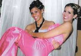 Charitie Foss  of Woodbury  holds her prom date  Brittany Stowman  of Oakdale