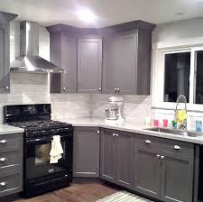 black appliance matte seamless kitchen: grey cabinets black appliances silver hardware full tile backsplash really good example