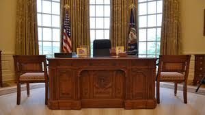 a reproduction of the resolute desk in the oval office at the george w bush bush library oval office