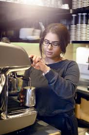 work experience options a young barista makes a coffee