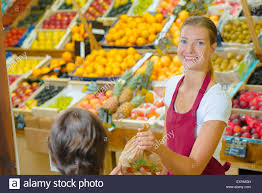 shop assistant serving customer in grocers stock photo royalty shop assistant serving customer in grocers