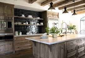 limed oak kitchen units: the limed oak cabinetry brightens up the kitchen and antique beams were brought in to accent