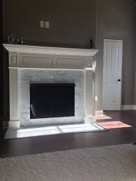 subway tiles tile site largest selection: carrara marble subway tile fireplace love it