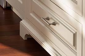 modern kitchen cabinet hardware traditional: a polished nickel bar pull combines modern sleekness with ease of use for this traditional painted cabinet drawer