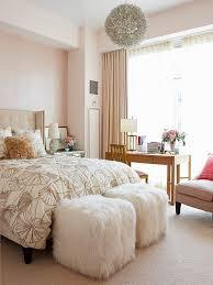 neutral bedroom with ottomans bhg bhg bedroom ideas master