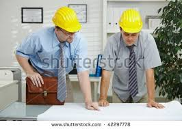 architects working at office planning and looking at blueprint on desk preview blueprints office desk preview save